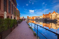 Old town of Gdansk reflected in the Motlawa river at sunrise, Poland Stock Photos