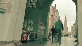 Gdansk, Poland - November 25, 2014: people walking through Golden Gate at Duga Street in the Old Town. Time-lapse. stock video footage