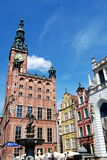 Gdansk, Poland: Ratusz (Town Hall) and Clocktower. Soaring Clocktower and Ratusz (Town Hall) with nearby handsome 17th century baroque mansions and 1633 Neptune Royalty Free Stock Photo