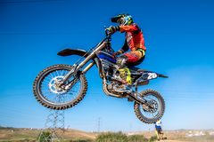 Motocross rider in the race Royalty Free Stock Photo