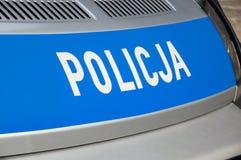 Gdansk Polen - April 27, 2017: Policja polisinskrift på den gråa bilen Royaltyfri Foto