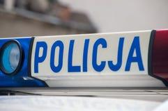 Gdansk Polen - April 27, 2017: Policja polisinskrift på den gråa bilen Royaltyfria Bilder