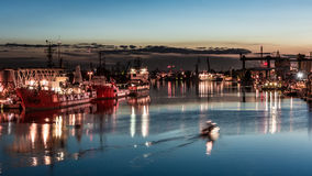 Gdansk Port at night. Gdansk Port and shipyard at night with lights reflecting on the water Royalty Free Stock Images
