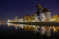 Gdansk of Riverside at night. The riverside with the characteristic Crane of Gdansk, Poland Stock Image