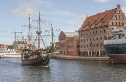 Gdansk, the ship. This picture shows a view of he old town in Gdansk, Poland. We can see the river with a beautiful, old-fashioned pirate-like ship sailing on Stock Photography