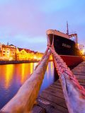 Gdansk Shipyard, Poland. Moltawa River in the night and SS SOLDEK, ship-museum, coal and ore freighter, the first ship built in Poland after World War II on July Royalty Free Stock Images