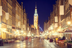 Gdansk Street with Town Hall at Night Royalty Free Stock Photos