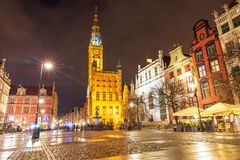 Gdansk Town Hall and the Fountain of Neptune in Long market, evening view royalty free stock photo