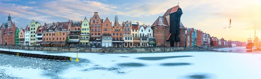 Gdansk winter panorama of the Motlawa embankment with Zuraw Port Crane and other old buildings stock photography