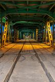 Gdanski Bridge at Night in Warsaw. Poland, illuminated wood and steel construction with tramway rails, capital city infrastructure, vanishing point perspective royalty free stock image