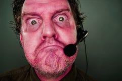 Gderliwi rewolucjonistek oczy i twarzy obsługi klienta mężczyzna z słuchawki Zdjęcia Royalty Free