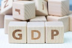 GDP, Gross Domestic Product concept, cube wooden block with alphabet combine abbreviation GDP, measure growth of country economic. Product and service royalty free stock photos
