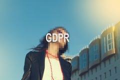GDPR -掩藏她的与题字GDPR的妇女面孔 库存照片