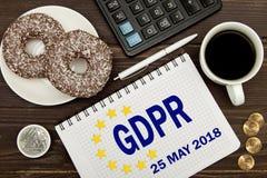 GDPR 有笔记一般数据保护章程的笔记本在商人的桌上 免版税图库摄影