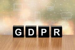 GDPR on black block with digital icon stock photo