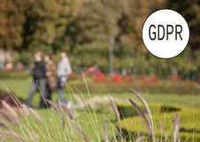 GDPR - city park with walking people. The image is blurred. In the upper right corner of the inscription General Data Protection royalty free stock photos