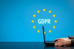 GDPR concept. GDPR general data protection regulation concept. Businessman or IT technologist with text GDPR and EU stars Royalty Free Stock Images