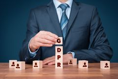 GDPR concept. GDPR general data protection regulation concept. Businessman or IT technologist with cubes with text GDPR and icons of people Stock Photo