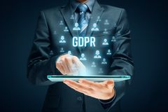 GDPR concept. GDPR general data protection regulation concept. Businessman or IT technologist with text GDPR and icons of people Stock Photo