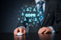 GDPR concept. GDPR general data protection regulation concept. Businessman or IT technologist with text GDPR and icons of people royalty free stock photography