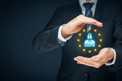 GDPR concept. GDPR general data protection regulation concept. Businessman or IT technologist with text GDPR, person with lock instead of head and EU stars royalty free stock photo