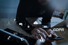 Designer using smart phone and keyboard dock digital tablet with. GDPR. Data Protection Regulation with Cyber security and privacy virtual diagram.designer using Royalty Free Stock Photo