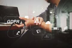 Man using VOIP headset with digital tablet computer docking smar. GDPR. Data Protection Regulation with Cyber security and privacy virtual diagram.Man using VOIP Stock Image