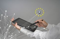 GDPR or DSGVO concept. General Data Protection Regulation, the protection of personal data. Young man with tablet works. GDPR or DSGVO concept. General Data Stock Photo