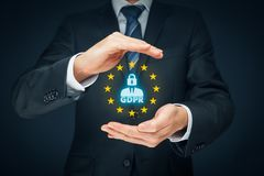 GDPR concept. GDPR general data protection regulation concept. Businessman or IT technologist with text GDPR, person with lock instead of head and EU stars stock photography