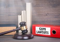 GDPR and lawsuits. Wooden gavel and books in background. Law and justice concept Royalty Free Stock Photos