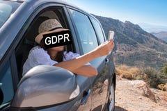 GDPR Młoda kobieta z smartphone chuje jej twarz z wpisowym Ogólnych dane ochrony przepisem zdjęcia royalty free