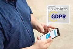 GDPR Message received an e-mail online on a mobile phone. Sending Message online . The concept of familiarization of people with the GDPR Stock Photography
