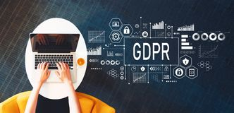 GDPR with person using a laptop. On a white table Royalty Free Stock Photography