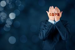 GDPR and personal information protection concept. Businessman, customer or internet user protect his face with hands with text GDPR stock photos