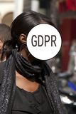 GDPR - street portrait of an elegant girl, face is hidden by the inscription General Data Protection Regulation. Cyber security stock image