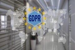 GDPR sul touch screen con un fondo della sfuocatura dell'ufficio T fotografie stock