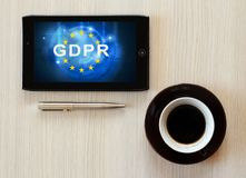 Gdpr text on tablet screen. Lying on table stock image