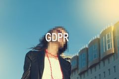 GDPR - woman hiding her face with an inscription GDPR. stock photo