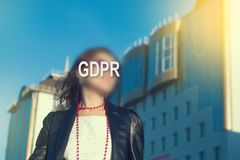 GDPR - woman hiding her face with an inscription GDPR. royalty free stock images