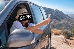 GDPR. A young woman with a smartphone hiding her face with the inscription General Data Protection Regulation. royalty free stock photos