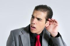 gdy biznesmena głuchoty uszaty ręki znak Zdjęcia Stock