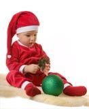 gdy chłopiec Claus ubierał małego Santa Fotografia Royalty Free