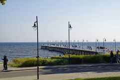 Gdynia Orlowo, people walking along the pier on sunny day. Royalty Free Stock Images