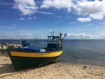 Gdynia Orlowo, Poland beach with moored fishing boats royalty free stock photos