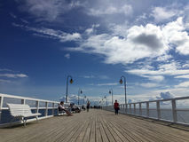 Gdynia Orlowo, Poland: people on the pier on summer day royalty free stock photo