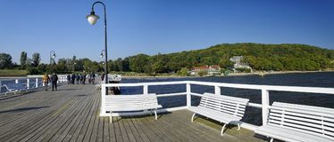Gdynia Orlowo, people walking along the pier on sunny day. Royalty Free Stock Image