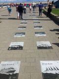 Gdynia, Polonia: Passaggio pedonale del sud del molo con i piatti marittimi Immagini Stock Libere da Diritti