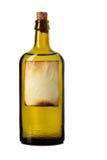 Geëtiketteerdeb fles met transparante vloeistof royalty-vrije stock foto's