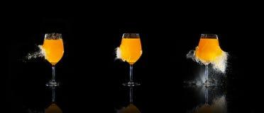 Geëxplodeerdeg glazen met jus d'orange Royalty-vrije Stock Afbeelding