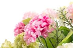 Geïsoleerd beeld van de valse bloem met vaas op witte achtergrond stock afbeelding